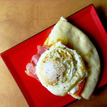 Symon's Soppressata Pizza with Fried Egg and Shasha Sauce