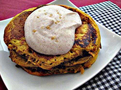 spiced pumpkin pancakes topped with cinnamon maple greek yogurt