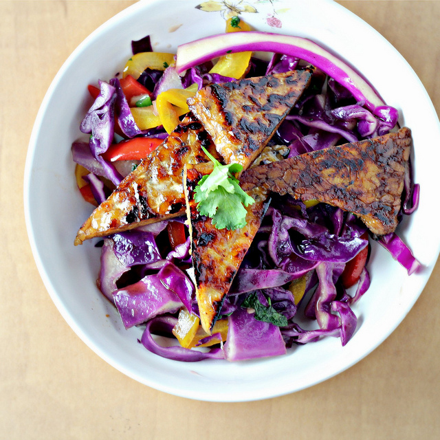 star anise-glazed tempeh with stir-fried peppers