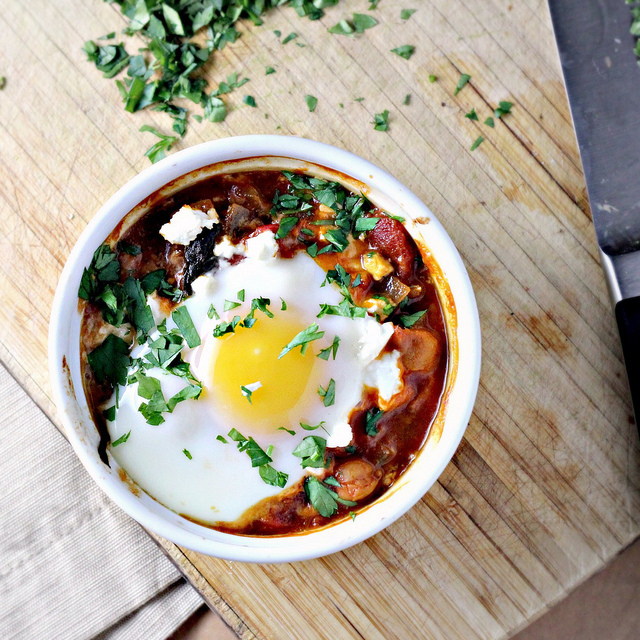 poached eggs in tomato sauce with chickpeas, feta and swiss chard