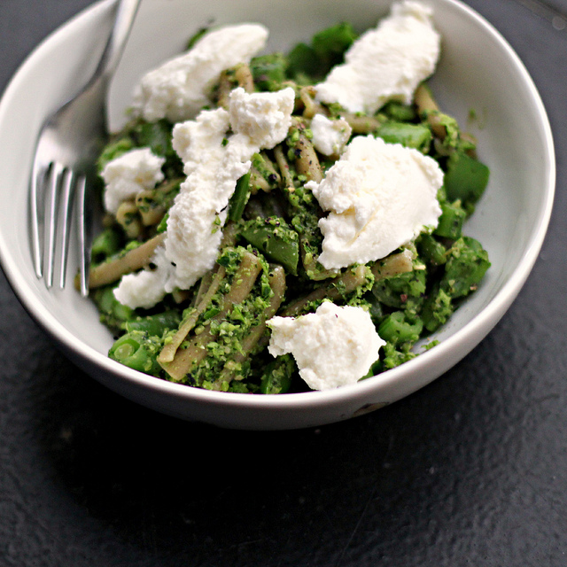 pasta with garlic scapes pesto, sugar snap peas and ricotta