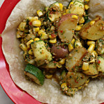 Roasted Potatoes, Zucchini and Corn Tostadas with Romesco Sauce (food matters project}