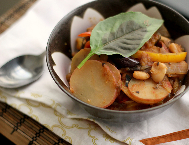 summer potatoes stewed with eggplant, peppers and olives