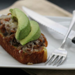 Open-Faced Grilled Cheese with Refried Beans, Caramelized Onions and Avocado on Cornbread