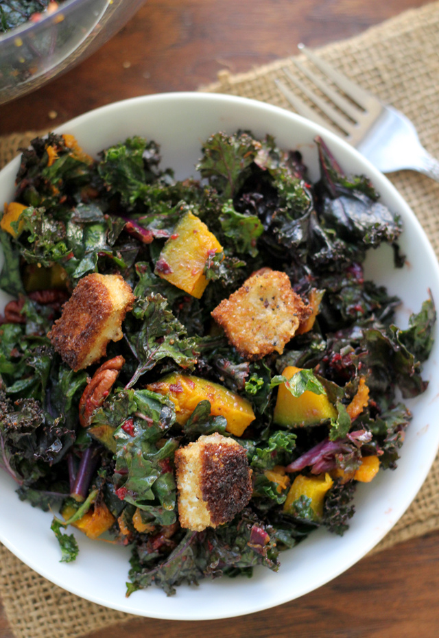 kale salad with brie croutons, roasted butternut squash, cumin-spiced pecans and a cranberry vinaigrette
