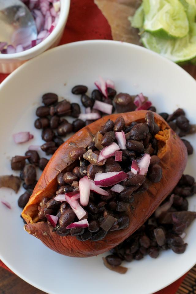 slow cooker black bean ragout on roasted sweet potatoes