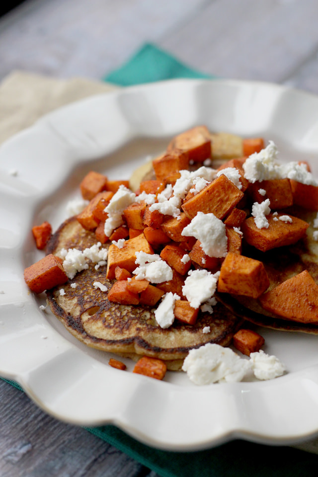 savory chickpea pancakes with spicy roasted carrots, sweet potatoes, and feta