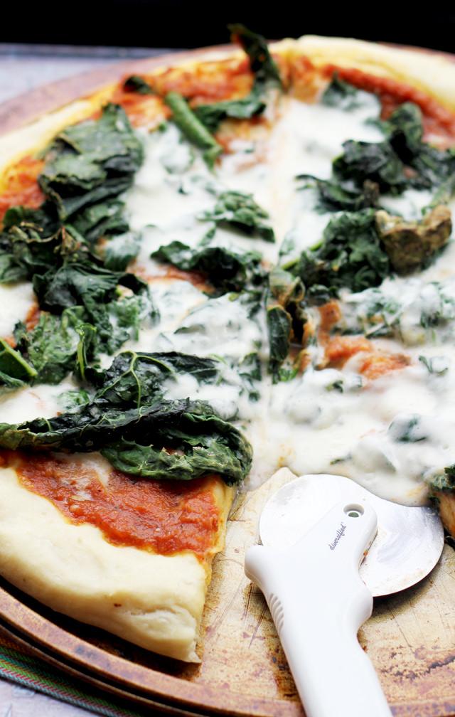 pumpkin-chipotle pizza with kale and burrata