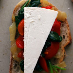 Caramelized Onion, Spinach, Roasted Red Pepper and Ricotta Salata Crostini