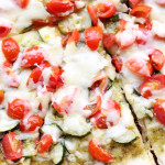 cherry tomato, zucchini, and pesto pizza