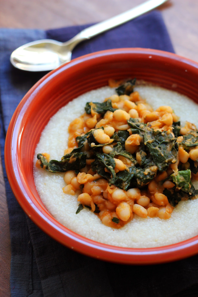 cajun white beans and kale over creamy grits