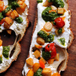 honey chipotle-roasted parsnip and carrot crostini with whipped ricotta and pesto