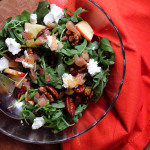 arugula, apple, candied pecan, and goat cheese salad with cider vinaigrette