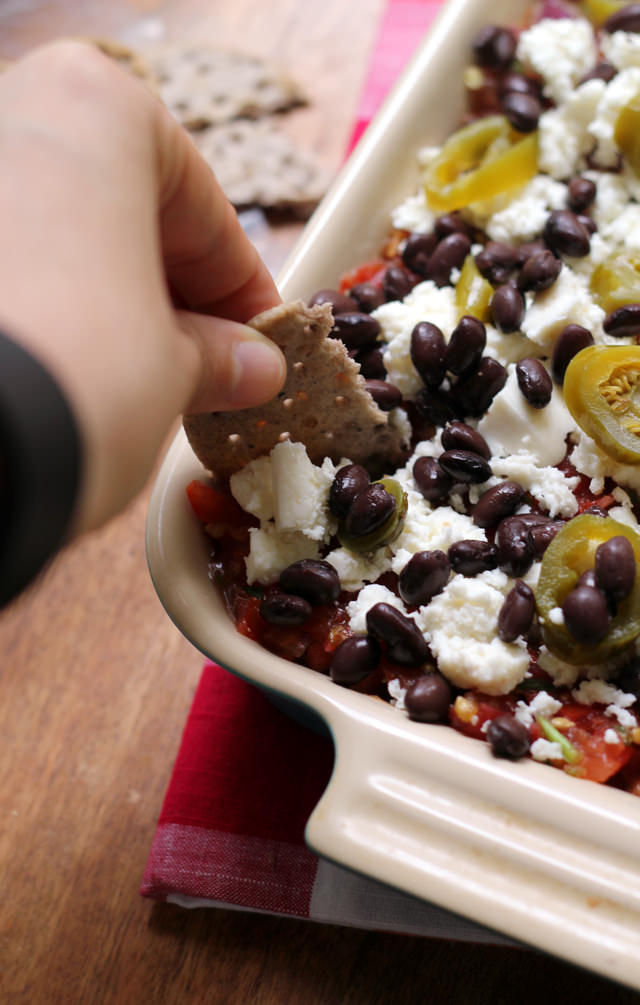 Mexican 5-layer bean dip with layers of refried beans, fresh tomato ...