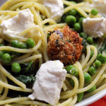 spaghetti with eggplant balls, pesto, peas, and greens