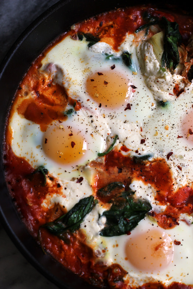 sicilian baked eggs with artichokes, burrata, spinach, and spicy tomato sauce