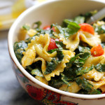 tuscan kale, bell pepper, zucchini, and tomato pasta salad with basil pesto vinaigrette