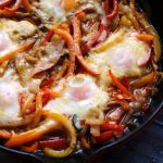 Beer-Baked Eggs with Peppers and Onions
