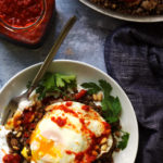 Farro and Lentil Mujaddara with Harissa, Toasted Pine Nuts, and a Fried Egg