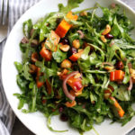 Persimmon and Pomegranate Salad with Arugula and Hazelnuts