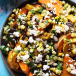roasted butternut squash with sweet corn salsa, feta, and pepitas