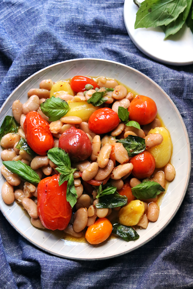White Bean and Roasted Cherry Tomato Salad with Basil, Chili, and Capers