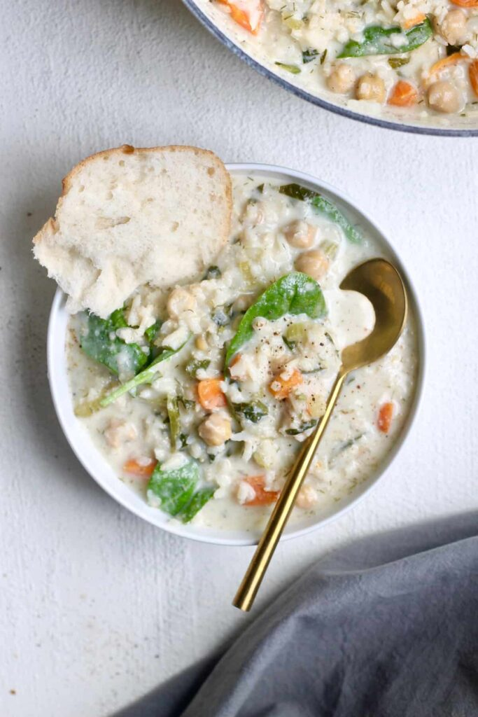 Lemon chickpea rice soup with gold spoon