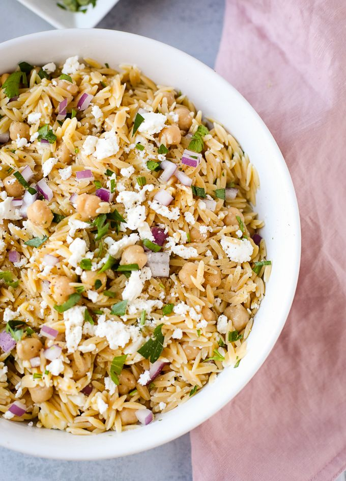 Feta orzo pasta salad in a white bowl