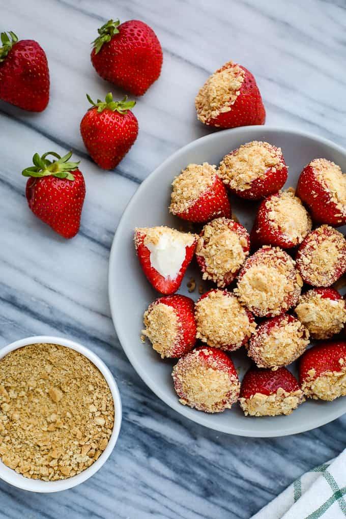 Cheesecake stuffed strawberries in a white bowl