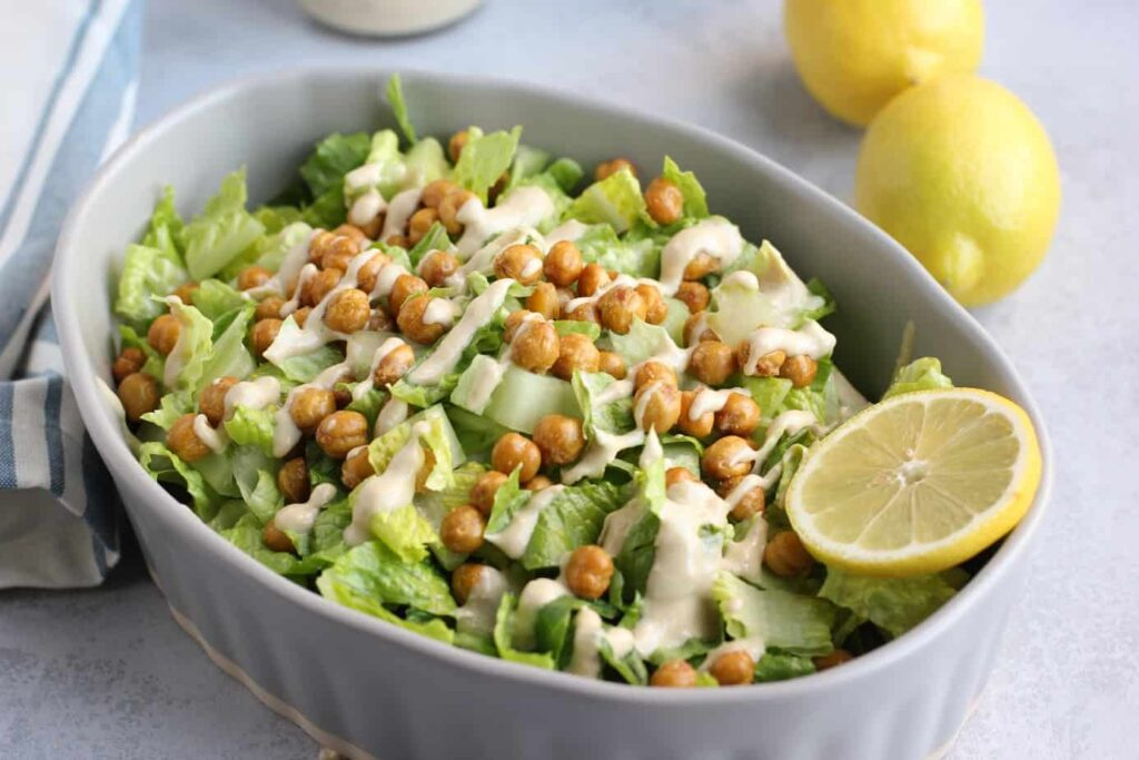 Caesar salad with crispy chickpeas in a white bowl