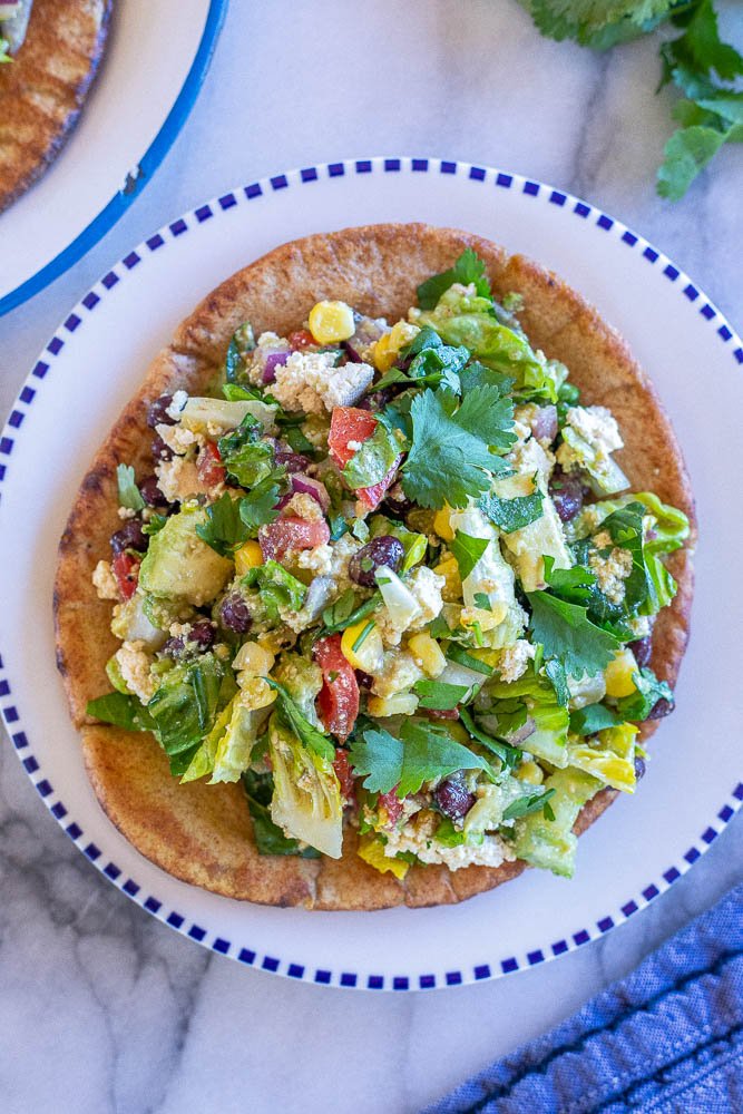 Mexican chopped salad pitas on a white and blue plate