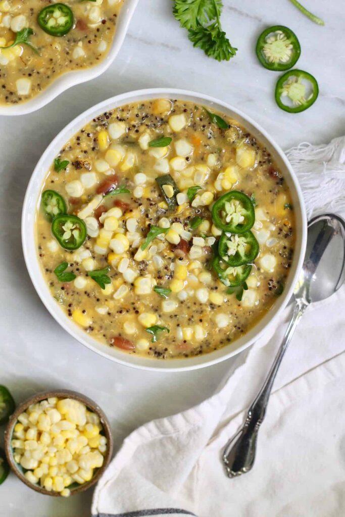 Corn chowder with quinoa in a white bowl
