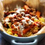Halal Street Cart Chickpeas with Turmeric Rice, Tahini Yogurt Sauce, and Harissa Oil
